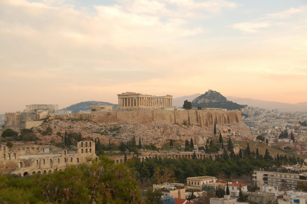 Mount Hymettus rises in the distance behind the Acropolis. Photo: RobW