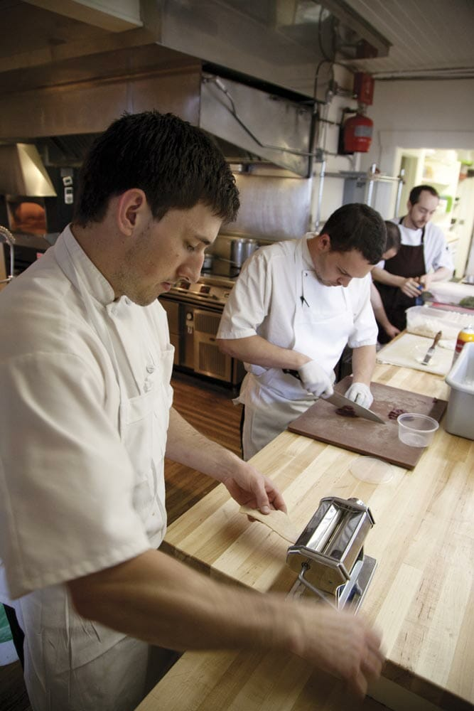 The kitchen at the Willows Inn restaurant, with Chef Blaine Wetzel in foreground
