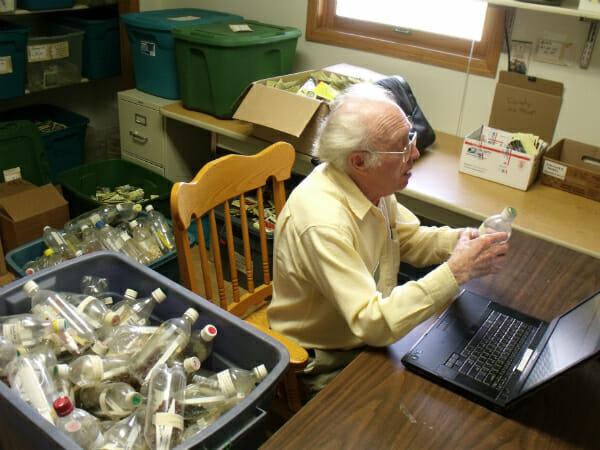 Richard Simon Hanson, volunteer at Seed Savers Exchange, inventories some of Fox's beans.