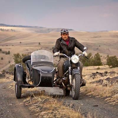 John Mionczynski on his motorocycle with sidecar, sans goat.