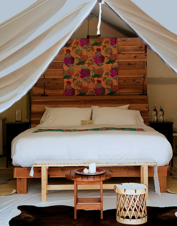 Built on wooden platforms, Cuatro Cuatros' cabins feature furnished patios, plush beds, cowhide rugs, running water and fireplaces.