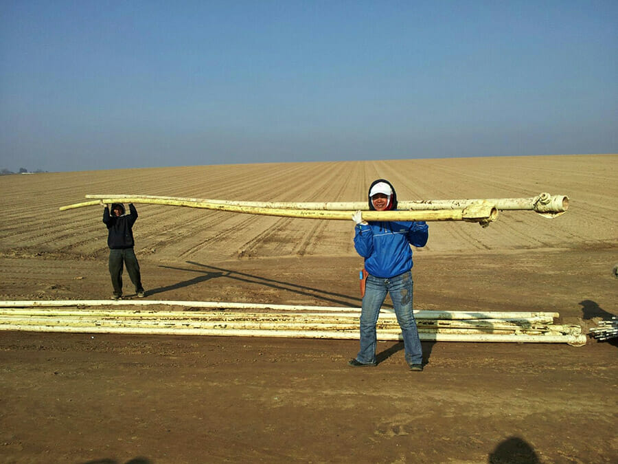 Carrying irrigation pipe lines near Hickman Ca. 2011.