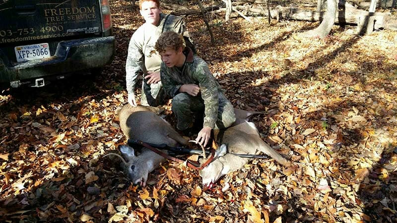 Posing with a recently killed deer are Howard Curtis' son (back) and nephew (front). Photo courtesy Howard Curtis.