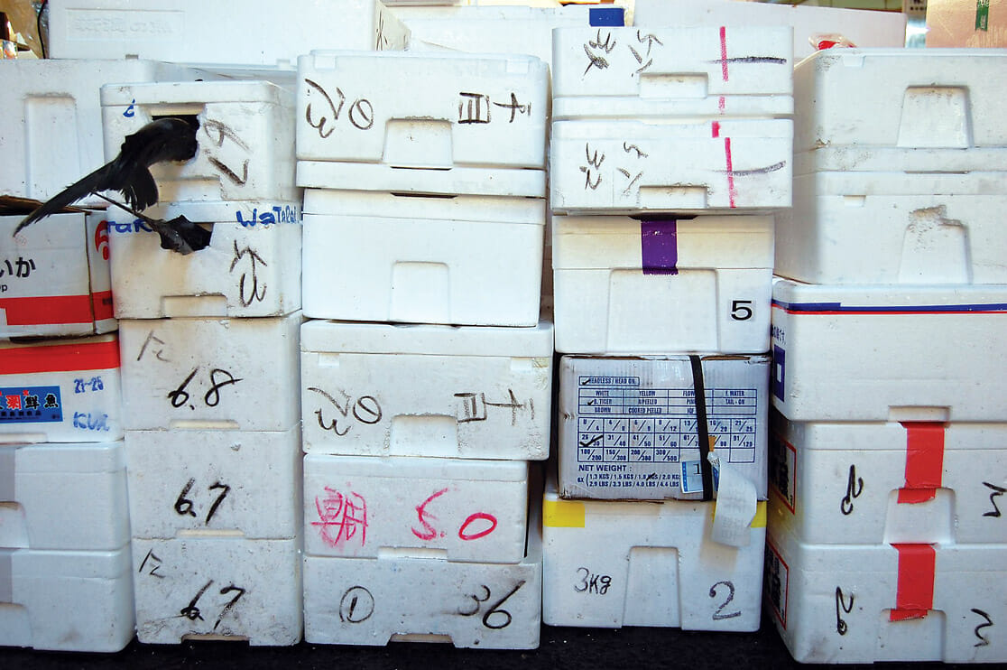 Fish 'coffins' (leak proof polystyrene boxes in which fish travel) at Tsukiji Market, Tokyo, Japan.
