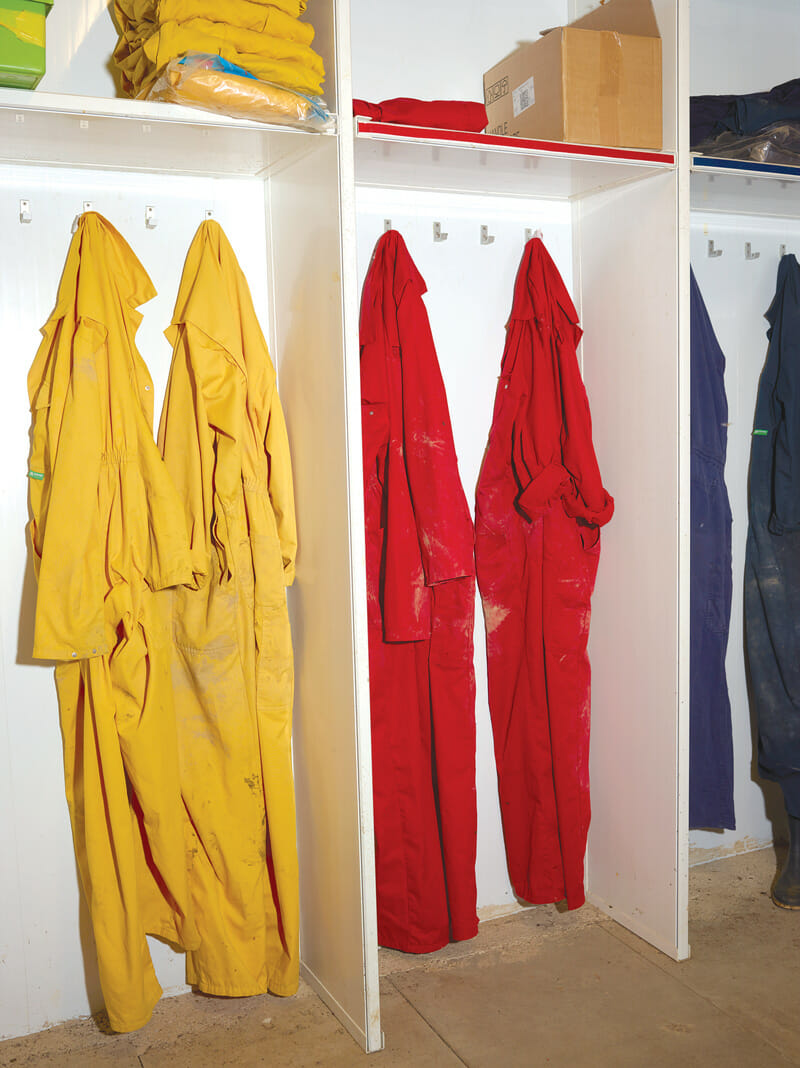Overalls and boots whose colors correspond to different zones, helping control the spread of diseases.
