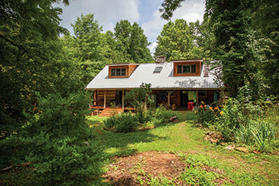 Students gather at Katz's solar-powered log cabin in rural Tennessee.