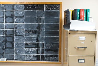 At the Webb County administrative office, livestock records are recorded on a chalkboard.