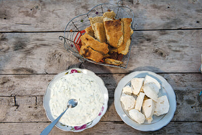 A northern Albanian feast in Theth: goat cheese, tzatziki (yogurt sauce with cucumber) and corn bread. / Courtesy Paolo Della Corte.