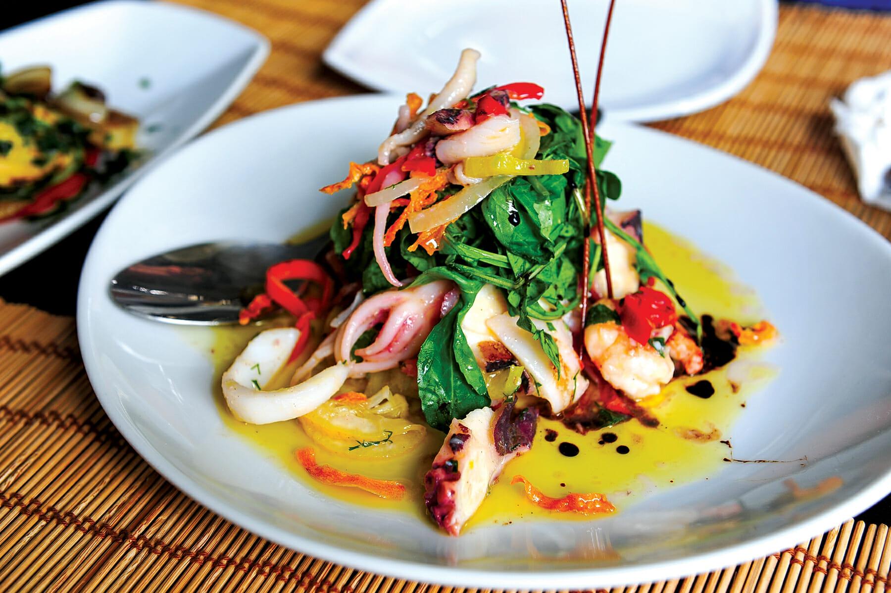 An Adriatic seafood salad (squid, octopus, shrimp, mussels) at Artigiano restaurant in Tirana's fashionable Ish-Blloku neighborhood. / Courtesy Merlin Bakus.
