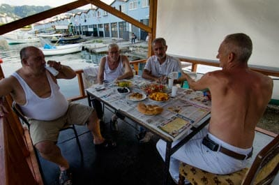 Black Sea fishermen drink raki and eat lunch at a fishing port just outside of Rize.