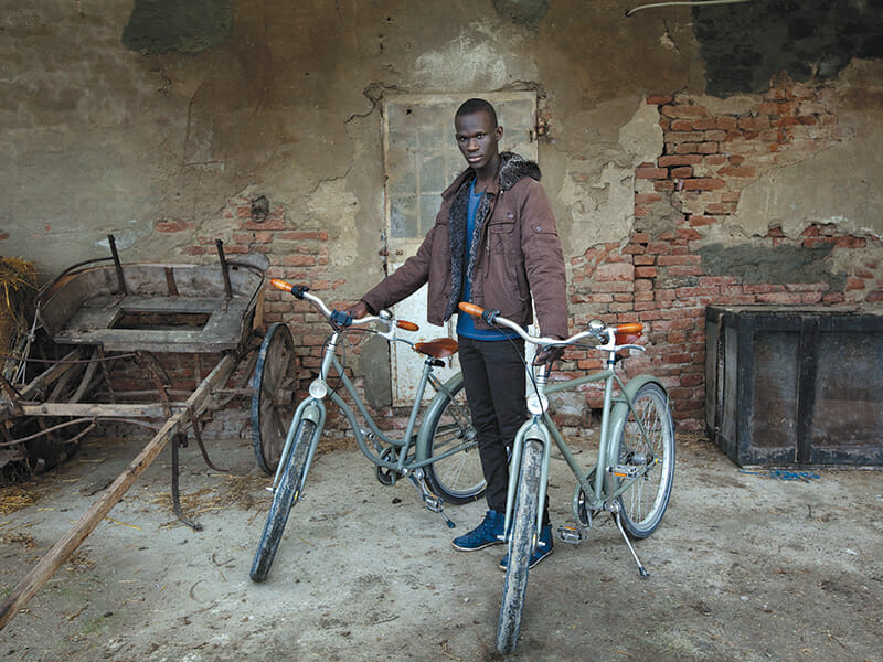 Omar Fall, 19, native of Senegal, is responsible for the maintenance of the handmade Abici bicycles available to guests.
