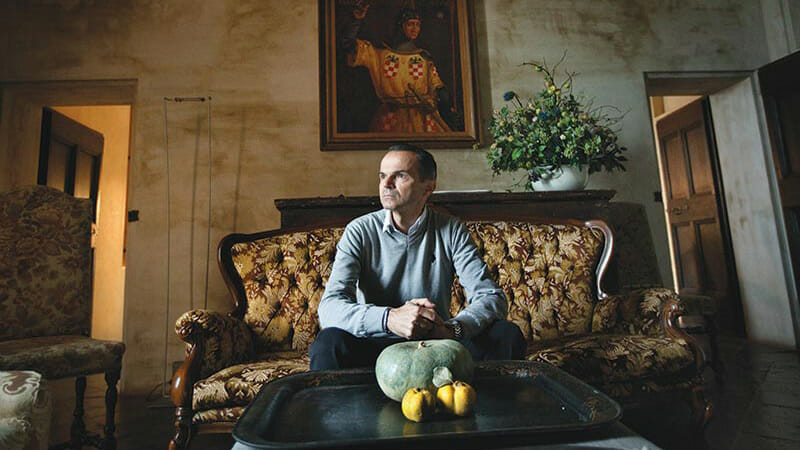 Luciano Spigaroli, co-owner of the Antica Corte Pallavicina, photographed in one of the castle's communal living rooms.