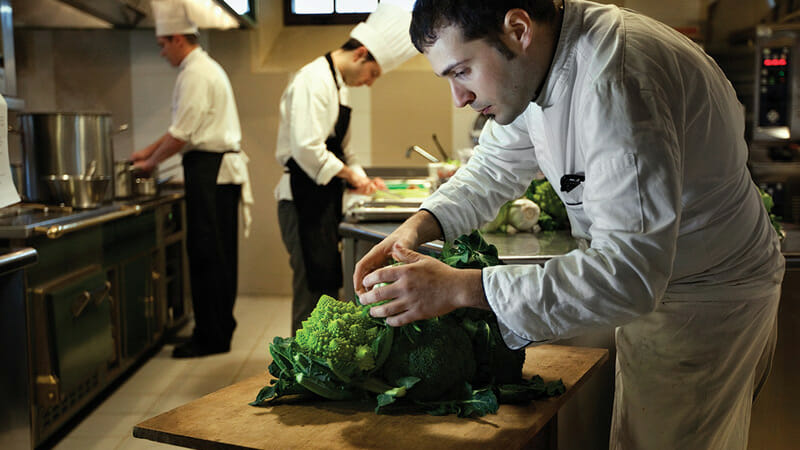 In the kitchen of the restaurant, chef Angelo Durante selects seasonal vegetables grown in the garden