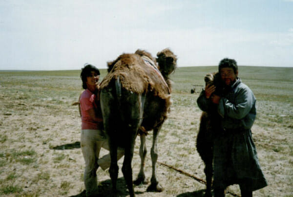 Badamsuren and his wife Battsetseg with a just-born camel foal.