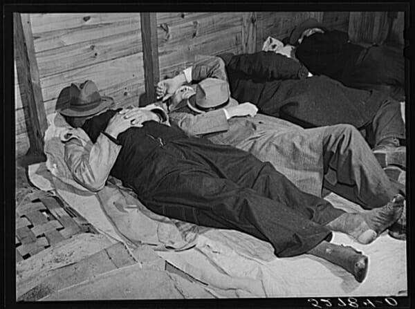 Tobacco farmers sleeping before auction, Durham, North Carolina.