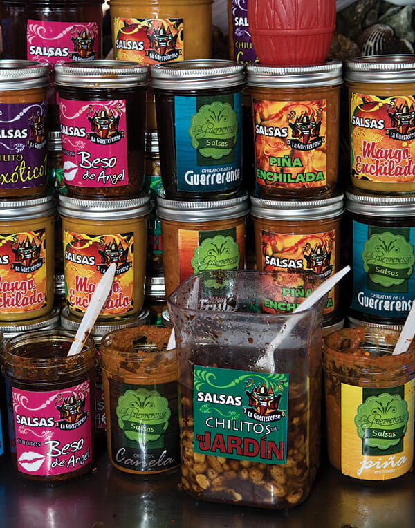 Ingredients in La Guerrerense's colorful salsas include whole peanuts and crushed chiles.