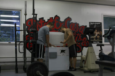 Members of CrossFit Woodshed shop for grass-fed meat.