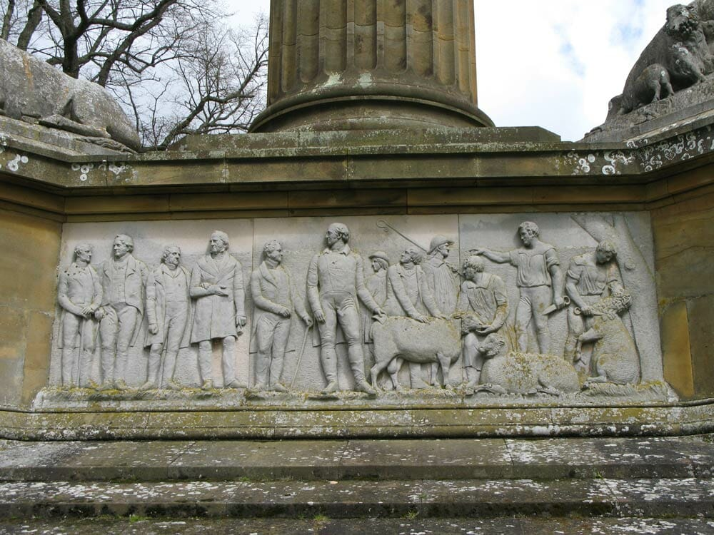 A detail of the Coke Monument at Holkham Hall, featuring sheep and their masters. / Courtesy Holkham Estate