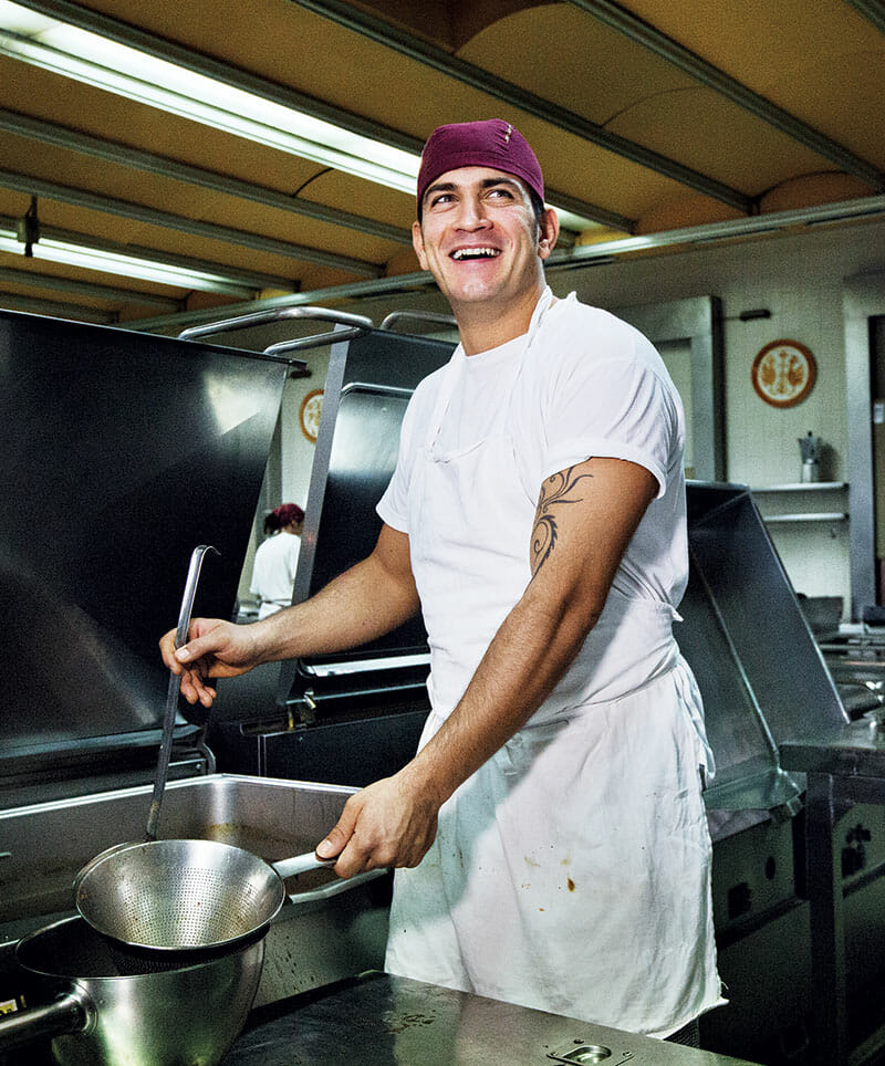 A resident works in San Patrignano's kitchen, where thousands of meals are served every day.