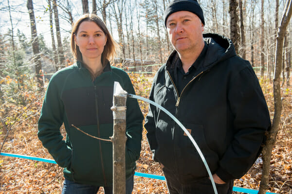 Drs. Tim Perkins and Abby van Den Berg of the University of Vermont's Proctor Maple Research Center, with the simple-looking invention that could radically change the maple syrup industry. / Photo: Sally McCay