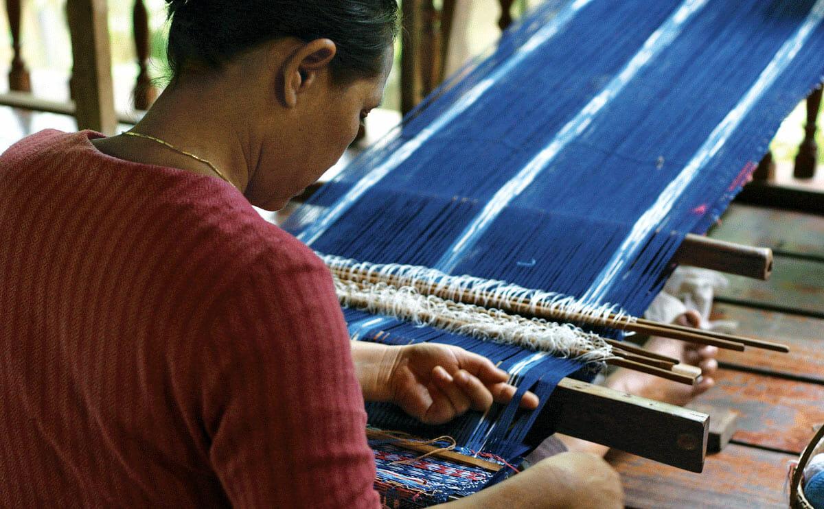 Saeng Sakorn, weaving on a back strap loom.