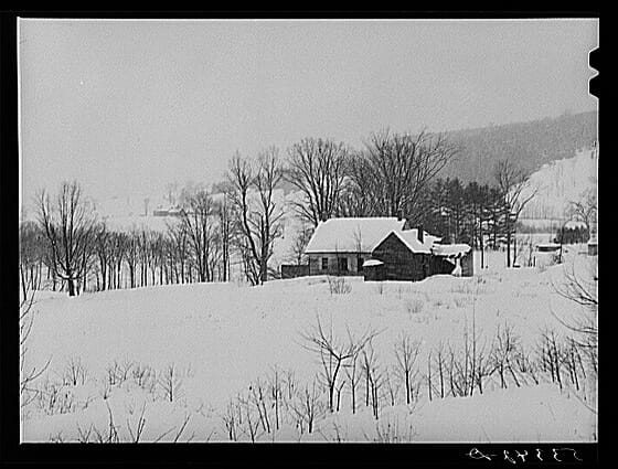 Fields and poor farms on stormy winter day near Taftsville. Windsor County, Vermont. Photographer: Marion Post Wolcott, ca. January 1939.