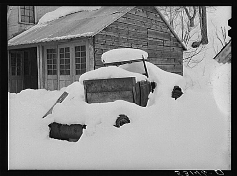 Truck snowed under on farm in Woodstock, Vermont. Photographer: Marion Post Wolcott, ca. March 1940.