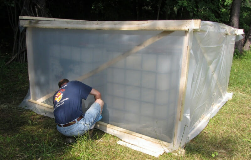 A greenhouse built to treat urine tanks for pathogens. The urine is sanitized after 30 days at or above 20°C (68°F).