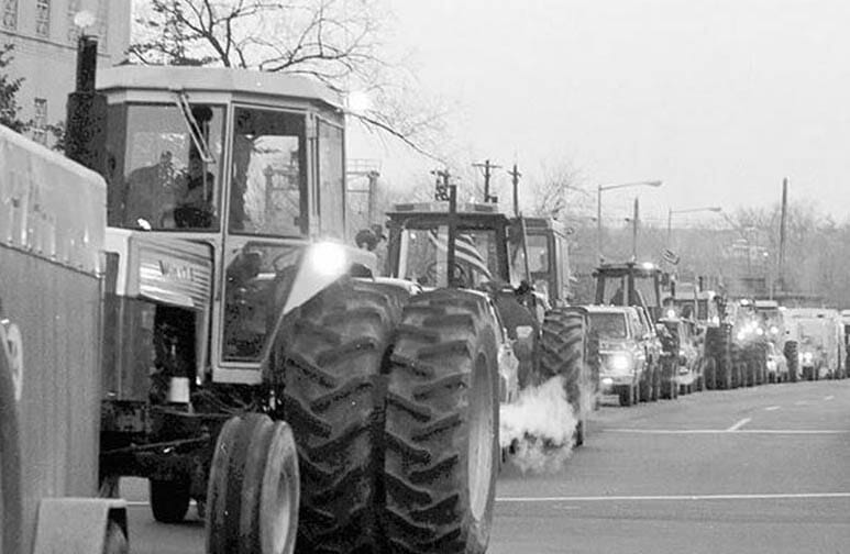 Tractors coming into Washington. Photo courtesy of the Smithsonian Institute. Photo by  J. Wooten.
