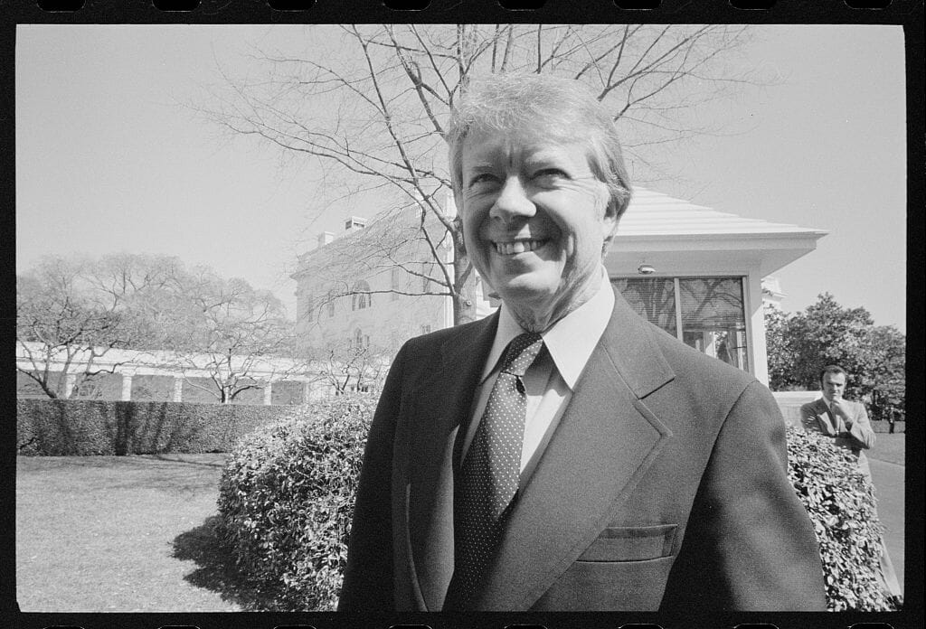 President Jimmy Carter at the White House. During his inauguration, Carter's family business was paid tribute in the form of a peanut float, ca. 1977.