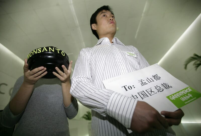 In 2009, Greenpeace activists held a letter to Monsanto's China CEO and a bowl of rice to protest in the lobby of a building where Monsanto has its office in Beijing.