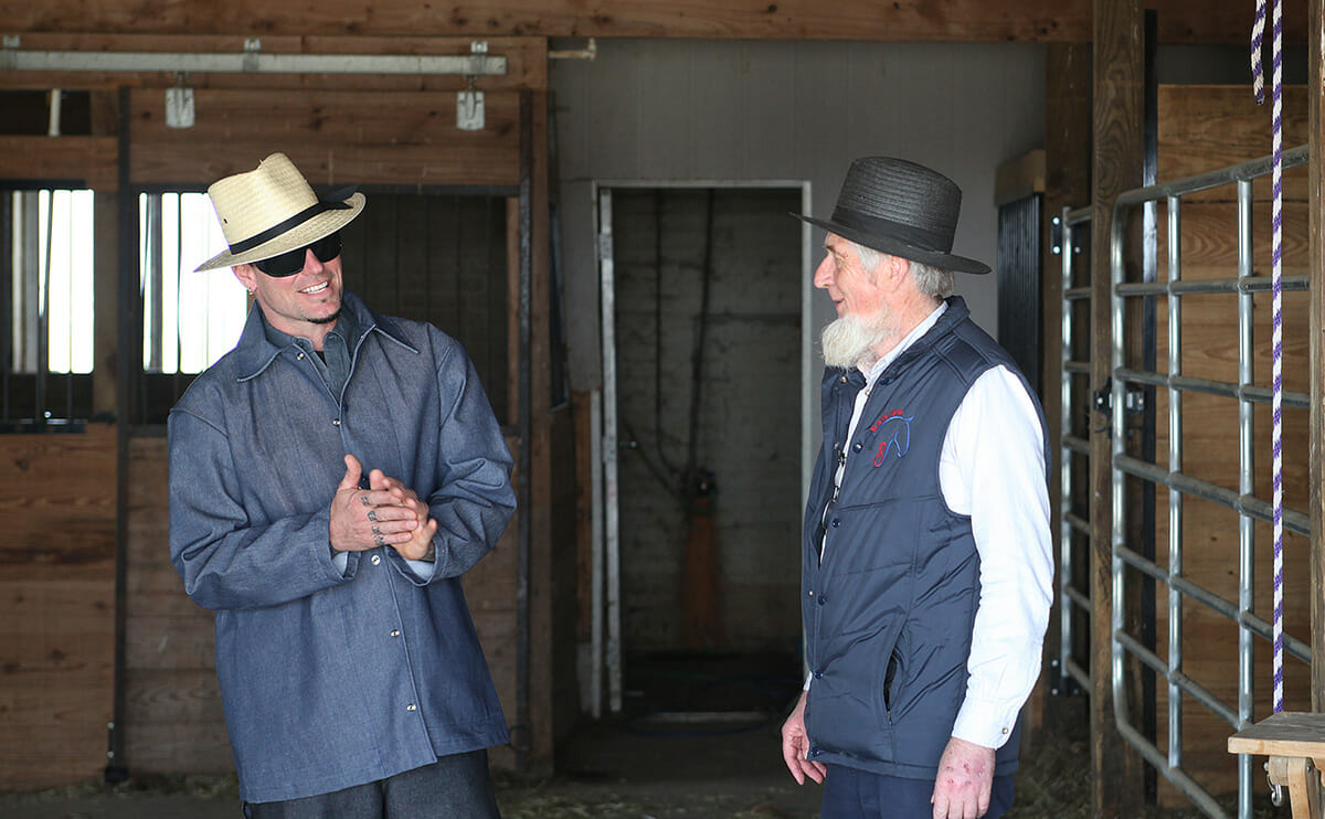 Vanilla Ice and an Amish man having a laugh.