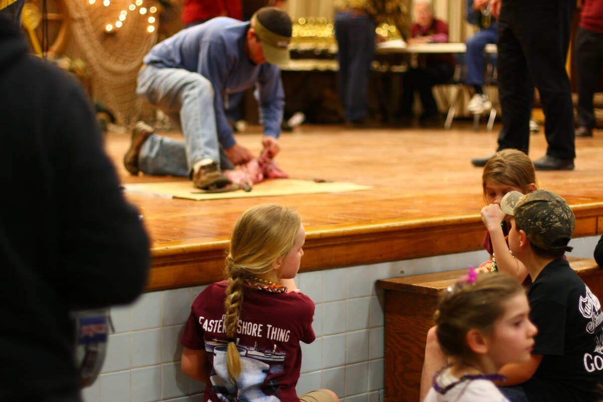 Young onlookers to one of many muskrat skinning competitors at the National Outdoor Show.
