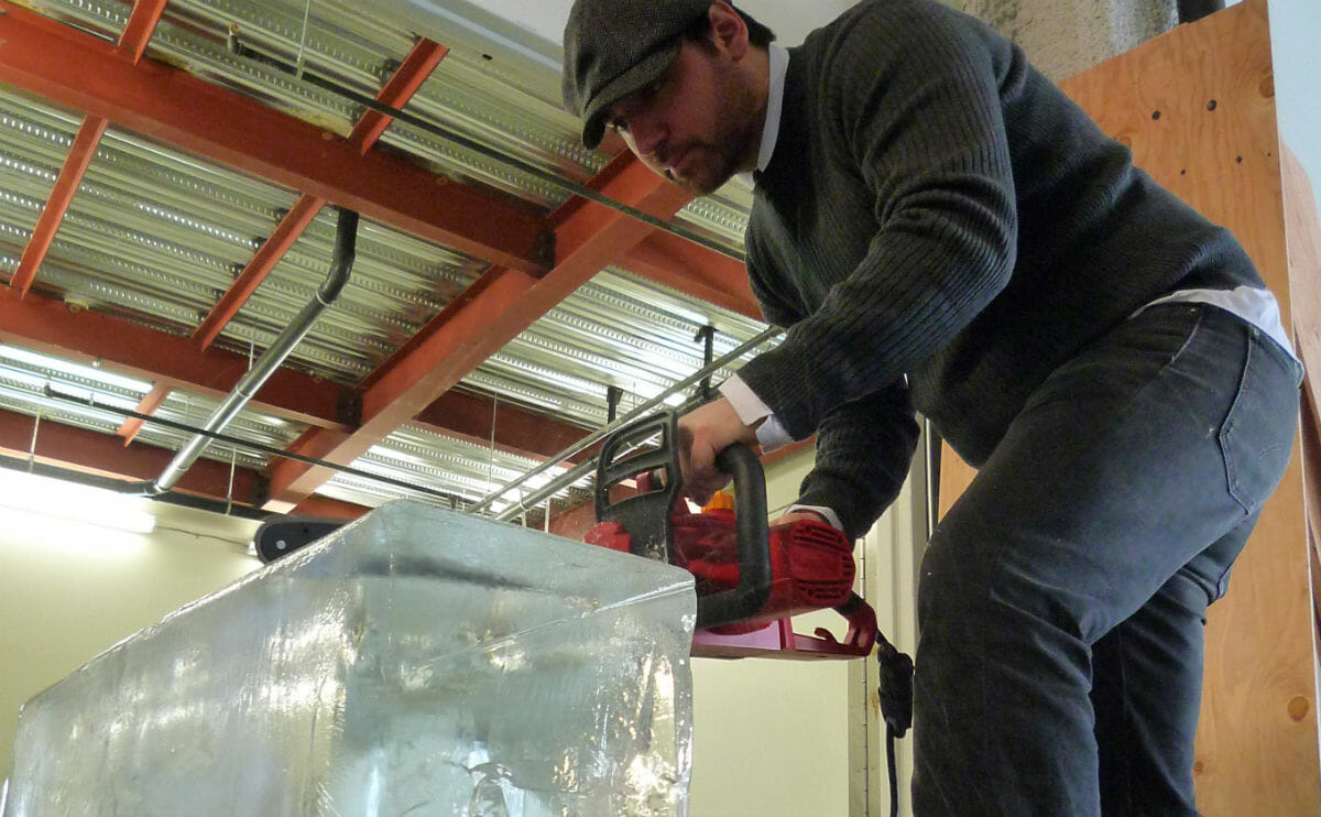 Bartender Zane Harris makes a cut on a 'Chainsaw Thursday' in 2010.