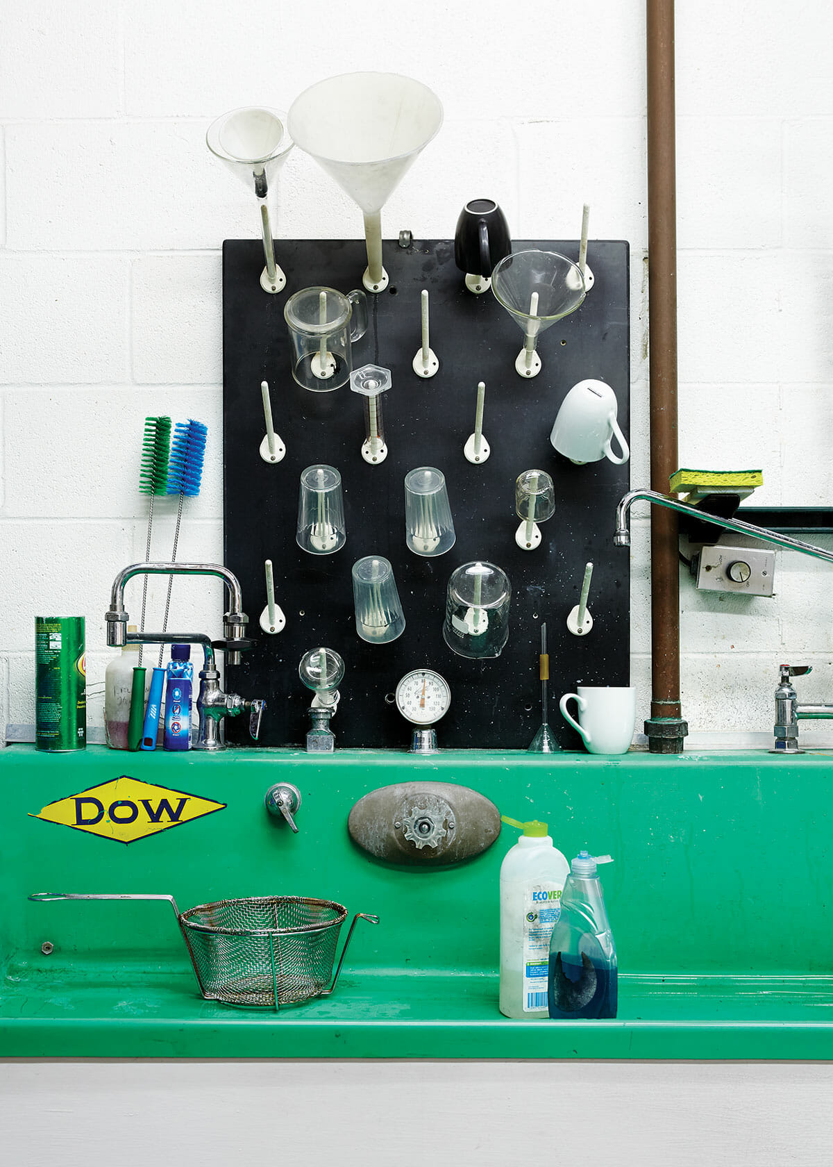 The glass-washing sink with glassware drying rack above. The sink was originally used for photographic developing.