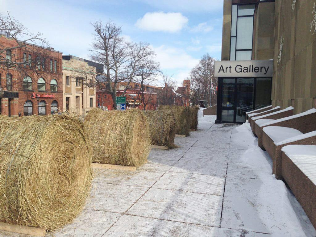 Monument (Pedestrian view), 2014. Living installation, Charlottetown, PE. Materials: 8 Round Hay Bales.