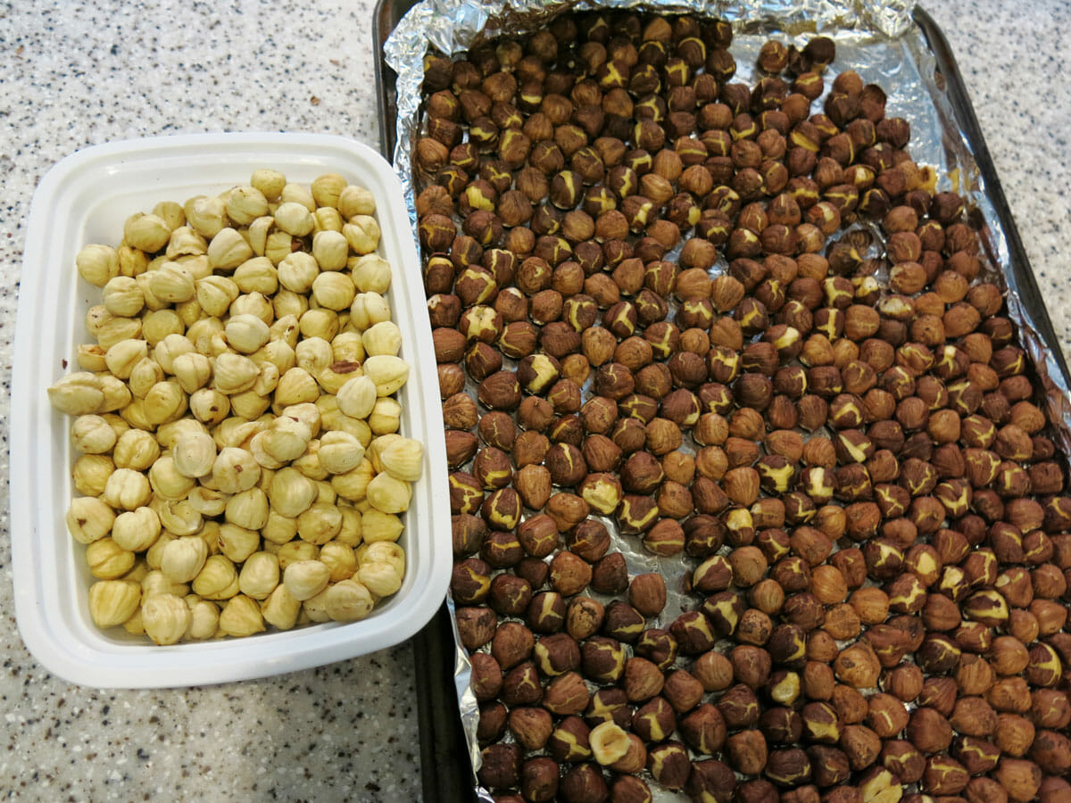 Roasted hazelnuts before and after being rubbed to remove pellicle.