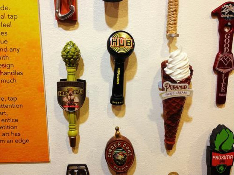 A wide collection of bottles and tap handles in Springfield, Oregon's exhibition, 'Behind the Label: The Art of Oregon's Craft Brewers.' Courtesy of Oregon Hops and Brewing Archives.