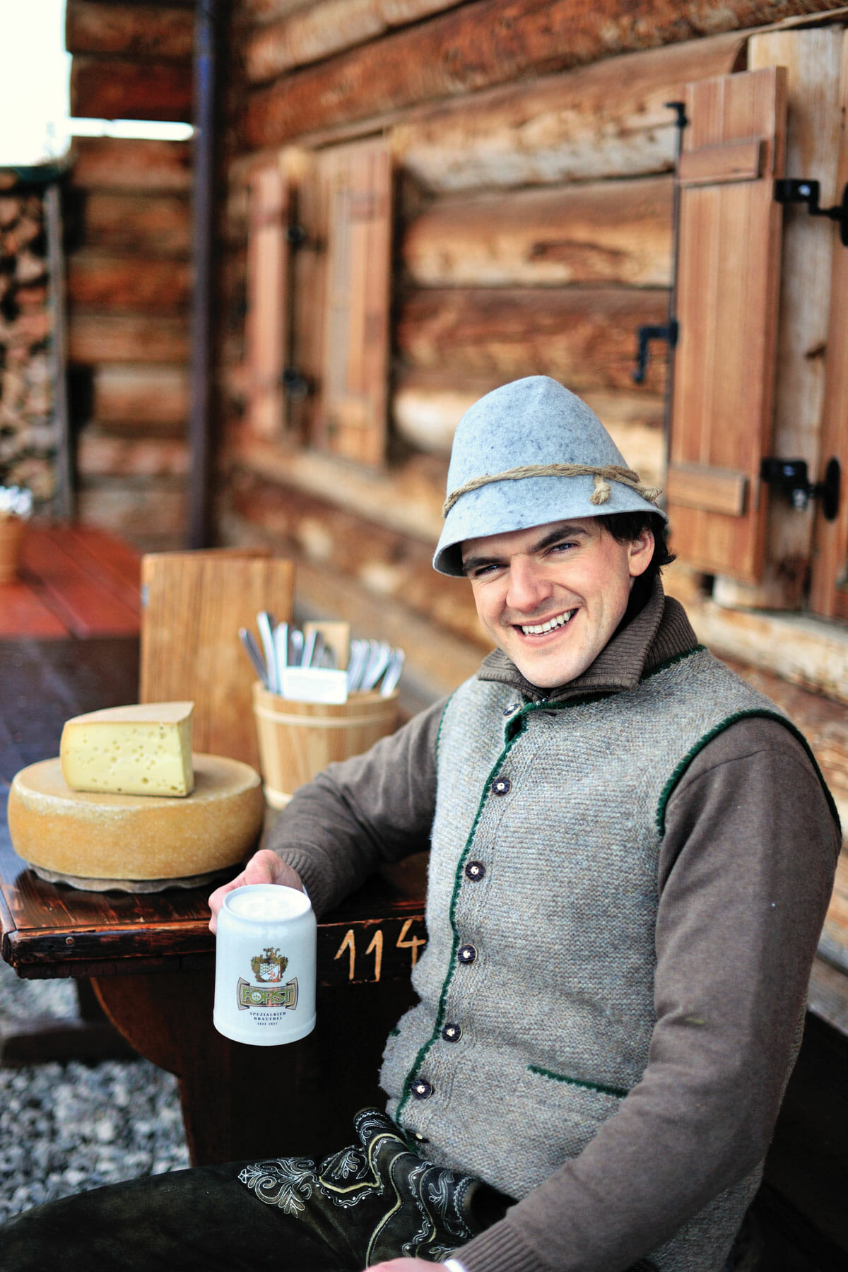 Chef Franz Mulser wearing his traditional felt hat and lederhosen. His kitchen, where he works with two sous chefs, is roughly the size of a closet.