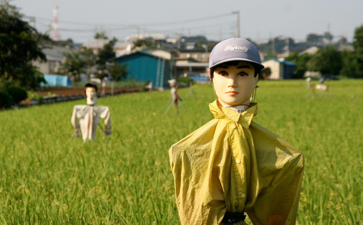In Japan, many farmers use old dolls heads or mannequins when crafting their scarecrows. Via Flickr / Kazu Lekyoite.