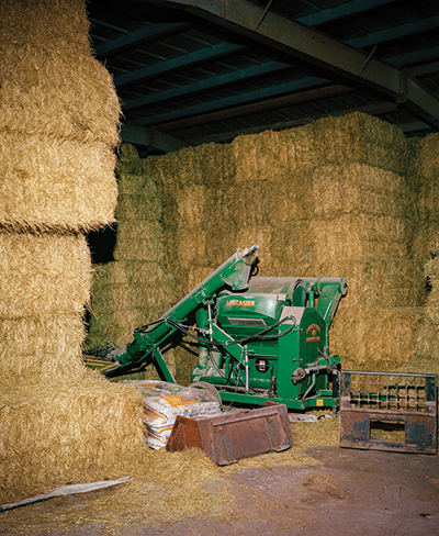 One of farming's many hazards has to do with the scale of its operations: like this grinder, pictured, surrounded by huge bales of hay. Falling hay might not seem that scary, but it can be lethal. In an incident in Clay County, Iowa, last March, a 49-year-old ag worker was unloading a semitrailer of hay when the top row of bales fell on him, resulting in his death.