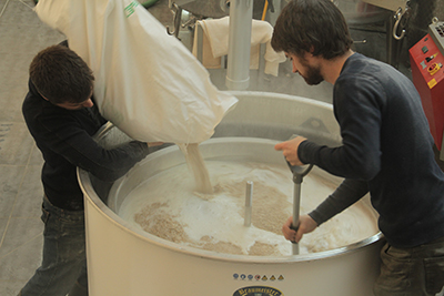 Mike Donohue and Thomas Deck making beer in their brewery in Montreuil. / Courtesy Benjamin Delaroche