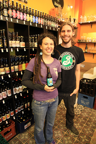 Pierre and Jaclyn Gidel with a bottle of La Levalloise in their shop, Biérocratie. / Courtesy Clément Leriche