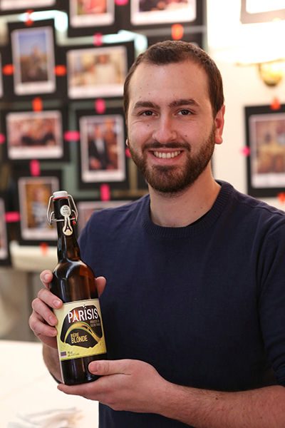 Brasserie Parisis founder Jonathan Abergel poses with his 'blonde' beer. / Courtesy Cervia Ile de France