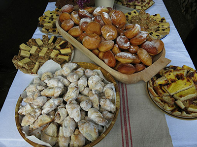 Doughnuts, crescent cookies similar to rugelach, and other desserts rounded out the meal.