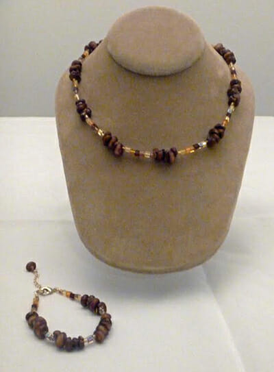 A corn necklace and corn bracelet made by Tara Barney.