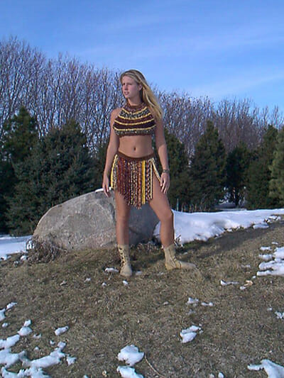 Heidi Scott's daughter, Inga, models a corn necklace, corn bra and loin corn skirt.