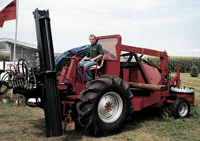 A combine-converted fence-building machine.