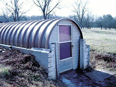 A greenhouse made by repurposing a fiberglass fuel tank.