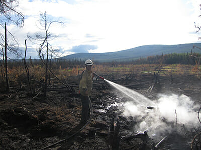 KT Scheer on the scene of a forest fire in Alaska.